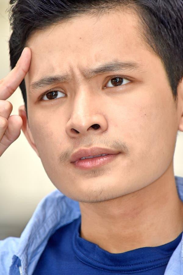 Νεανικός ασιατικός αρσενικός ψυχικός στοκ φωτογραφία με δικαίωμα ελεύθερης χρήσης