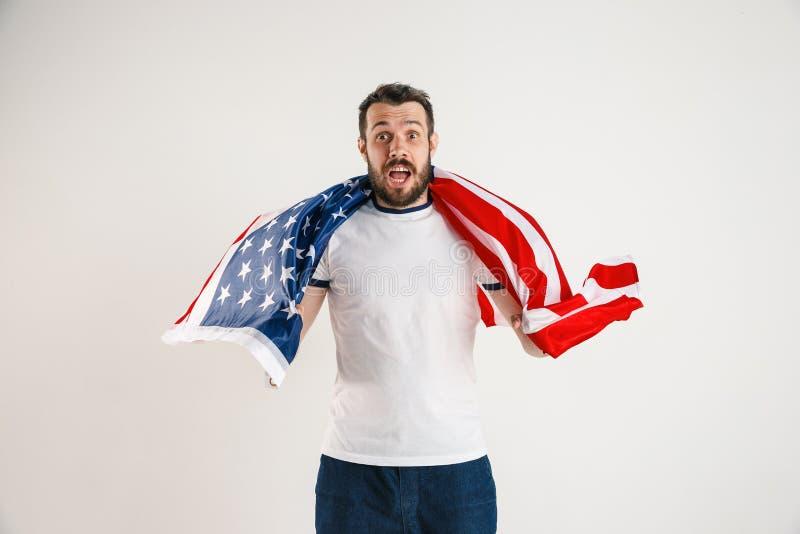 Νεαρός άνδρας με τη σημαία των Ηνωμένων Πολιτειών της Αμερικής στοκ φωτογραφίες