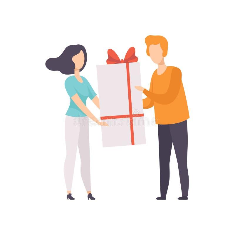 Νεαρός άνδρας που δίνει το μεγάλο κιβώτιο δώρων που διακοσμείται με το κόκκινο τόξο κορδελλών στο όμορφο κορίτσι brunette, άνθρωπ ελεύθερη απεικόνιση δικαιώματος