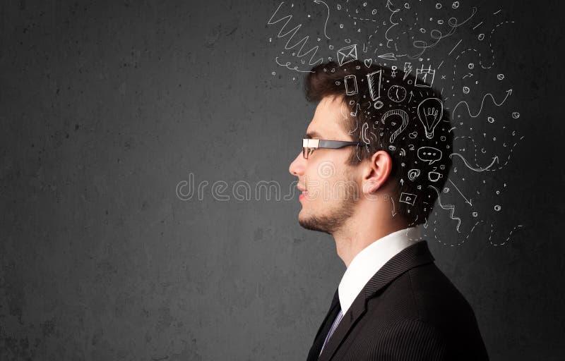 Νεαρός άνδρας που σκέφτεται με τις αφηρημένα γραμμές και τα σύμβολα στοκ φωτογραφίες