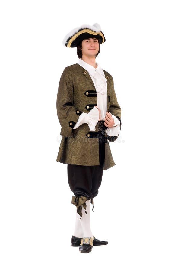 Νεαρός άνδρας σε ένα ιστορικό κοστούμι στοκ εικόνες