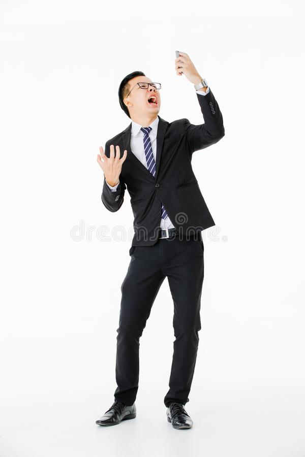 Νεαρός άνδρας στο απομονωμένο άσπρο υπόβαθρο στοκ φωτογραφία