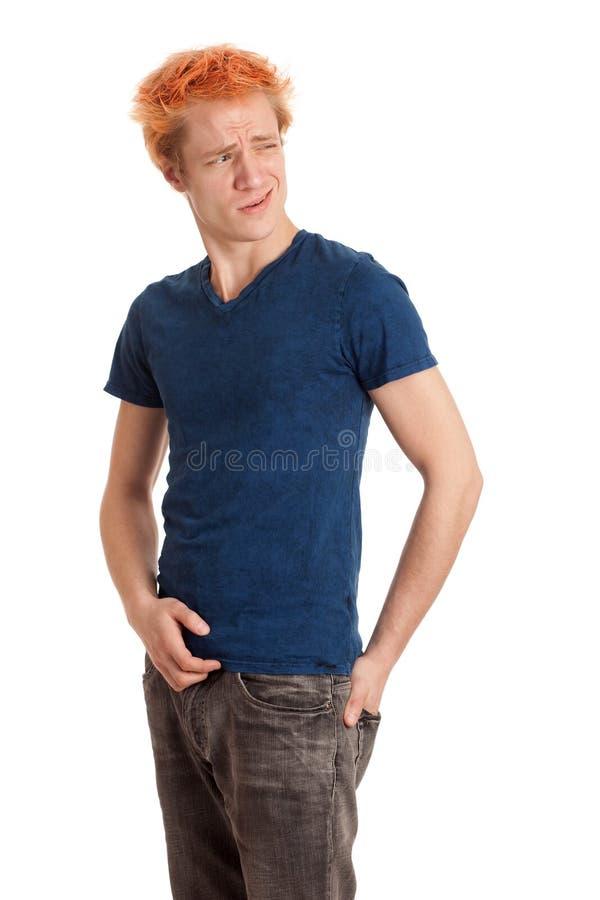 Νεαρός άνδρας στο μπλε πουκάμισο στοκ φωτογραφία