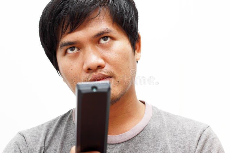 Νεαρός άνδρας με τον τηλεχειρισμό στοκ εικόνα