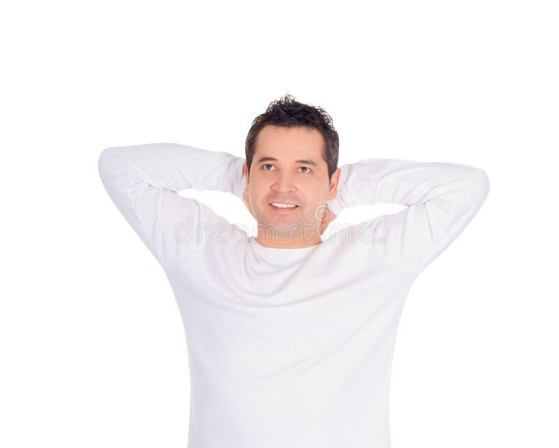 Νεαρός άνδρας που ονειρεύεται στο μέλλον του πέρα από το λευκό στοκ φωτογραφία με δικαίωμα ελεύθερης χρήσης