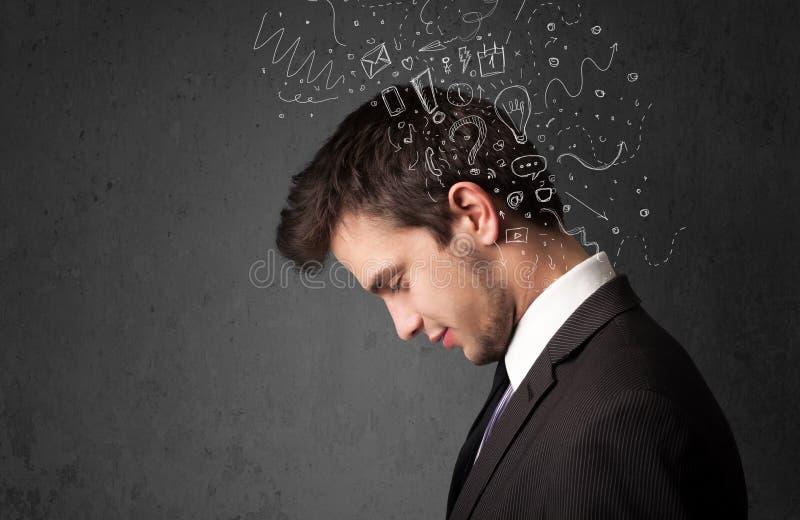 Νεαρός άνδρας που σκέφτεται με τις αφηρημένα γραμμές και τα σύμβολα στοκ εικόνα