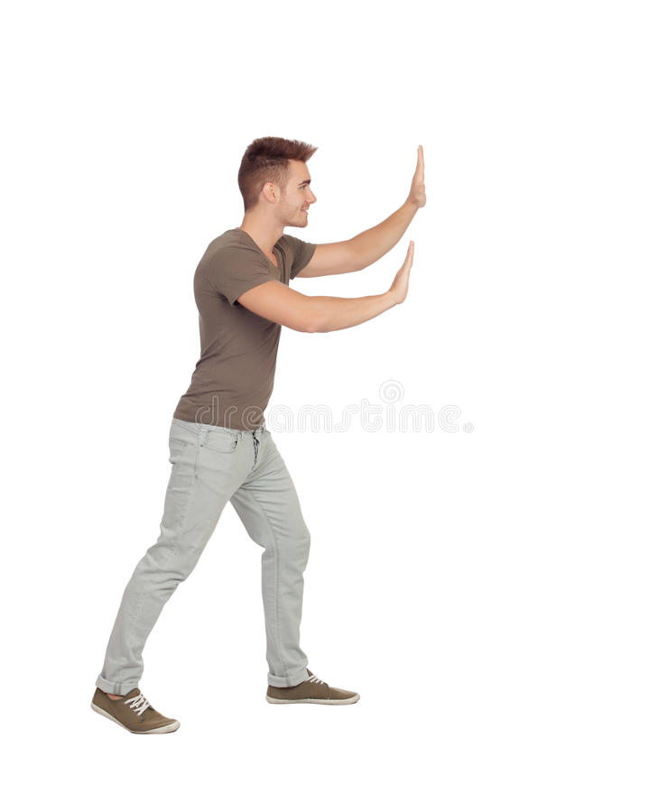 Νεαρός άνδρας που ωθεί κάτι στοκ εικόνες