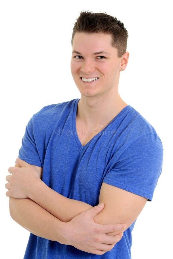 Νεαρός άνδρας στην μπλε μπλούζα στοκ φωτογραφία