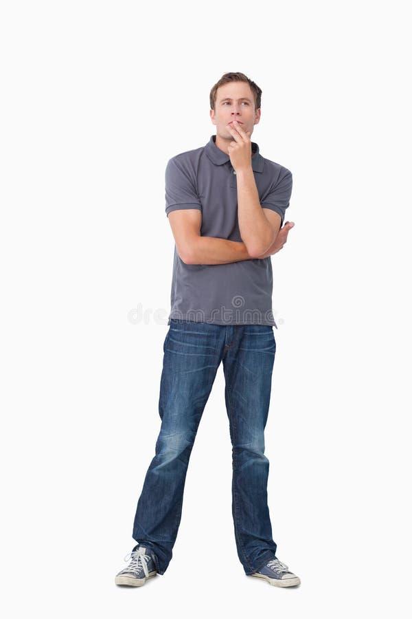 Νεαρός άνδρας στις σκέψεις στοκ εικόνες με δικαίωμα ελεύθερης χρήσης
