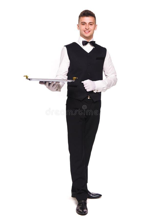 Νεαρό άτομο σε ένα κοστούμι που κρατά έναν κενό δίσκο απομονωμένο στο άσπρο β στοκ εικόνες
