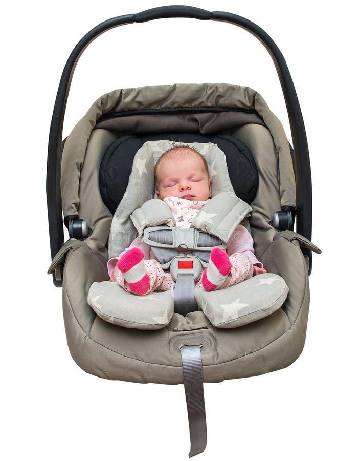 Νεογέννητο κοριτσάκι σε ένα κάθισμα αυτοκινήτων στοκ φωτογραφία με δικαίωμα ελεύθερης χρήσης