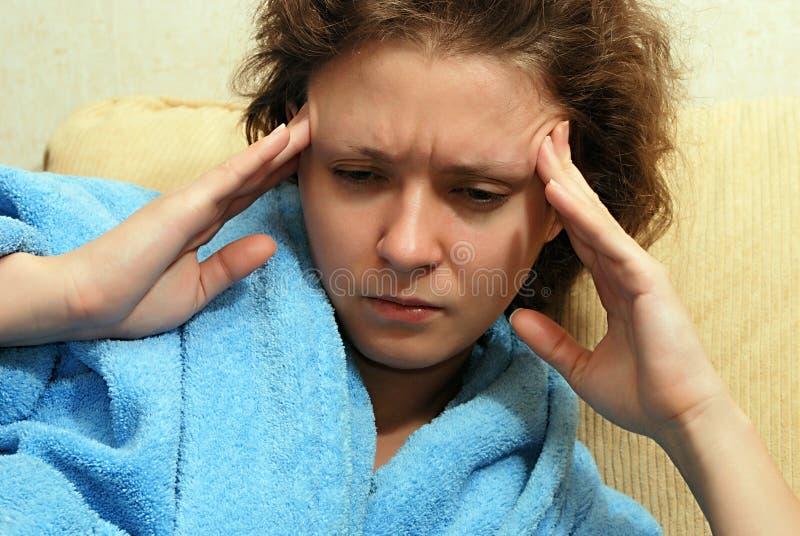 νεολαίες γυναικών πονο&k στοκ εικόνα