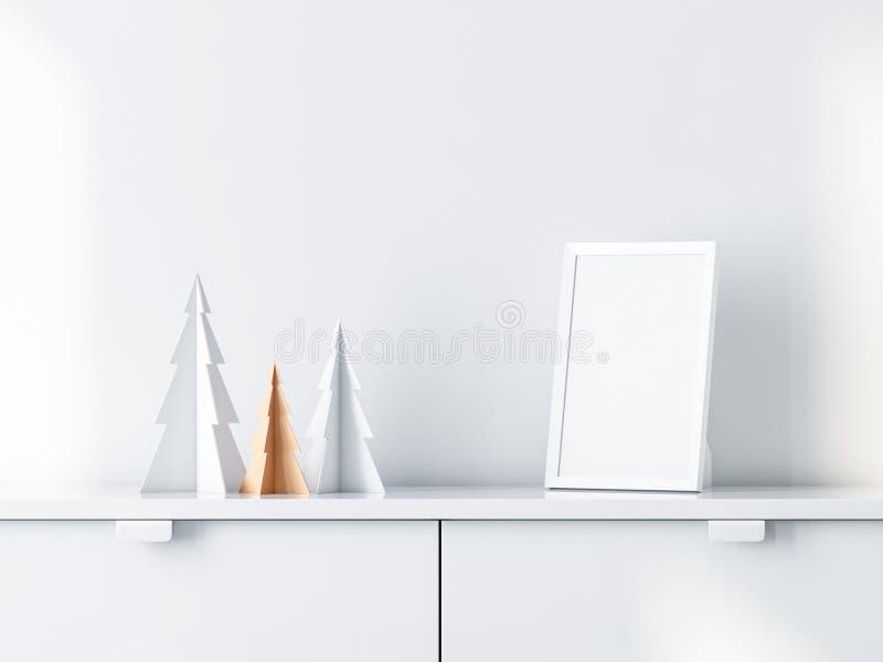 Ντεκόρ χριστουγεννιάτικων δέντρων με το άσπρο πρότυπο πλαισίων φωτογραφιών στο γραφείο ελεύθερη απεικόνιση δικαιώματος