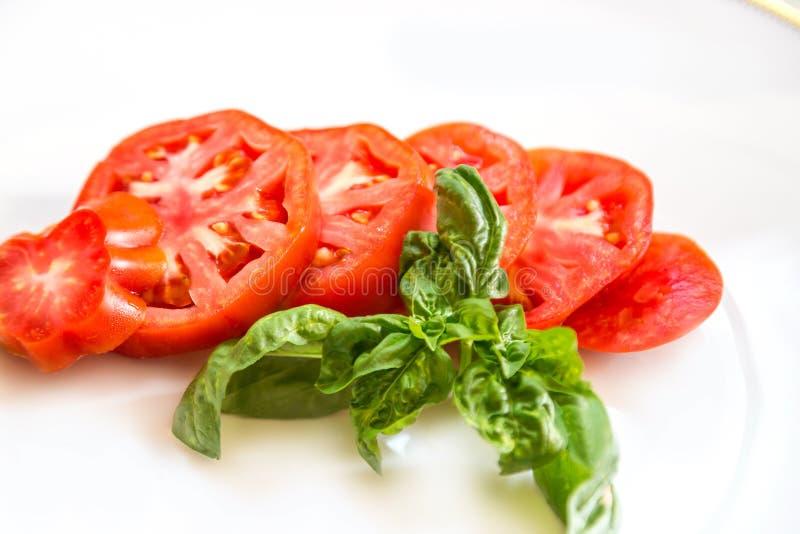 Ντομάτα και βασιλικός στοκ εικόνες