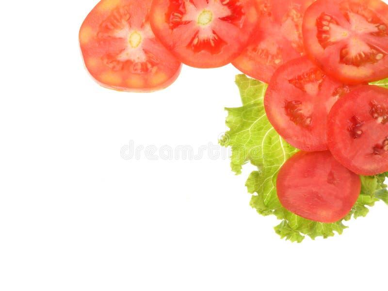 Ντομάτα που τεμαχίζεται που απομονώνεται στο άσπρο υπόβαθρο στοκ εικόνα