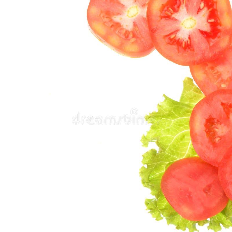 Ντομάτα που τεμαχίζεται που απομονώνεται στο άσπρο υπόβαθρο στοκ φωτογραφία με δικαίωμα ελεύθερης χρήσης