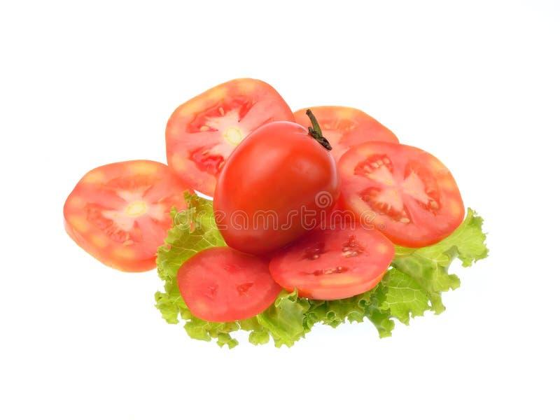 Ντομάτα που τεμαχίζεται που απομονώνεται στο άσπρο υπόβαθρο στοκ εικόνες