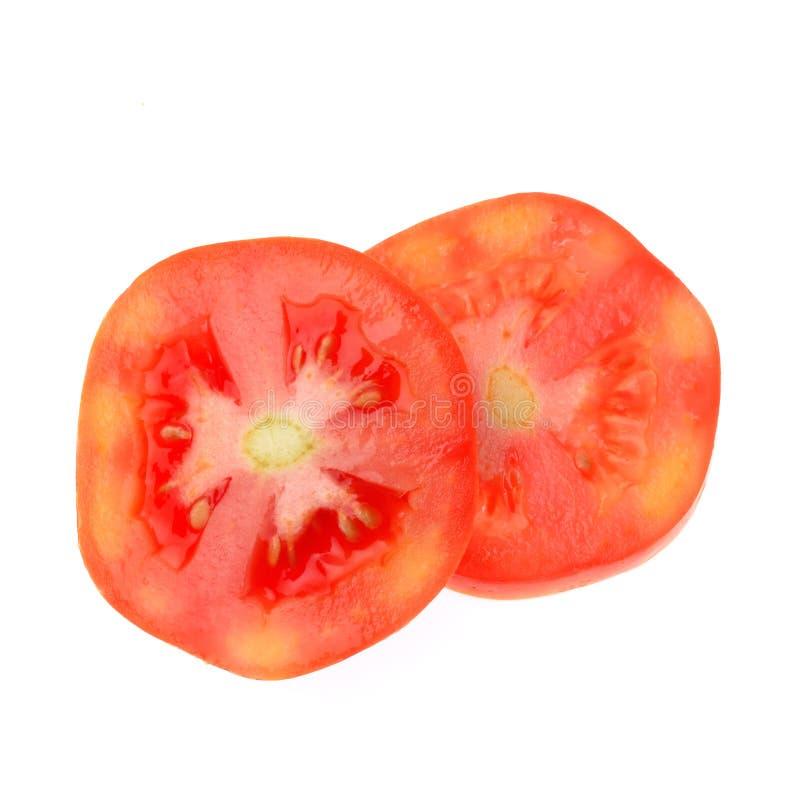 Ντομάτα που τεμαχίζεται που απομονώνεται στο άσπρο υπόβαθρο στοκ φωτογραφία