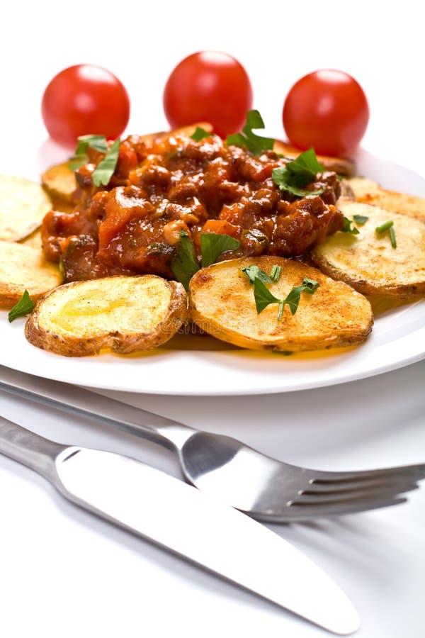 ντομάτα σάλτσας πατατών κρέ&al στοκ εικόνες