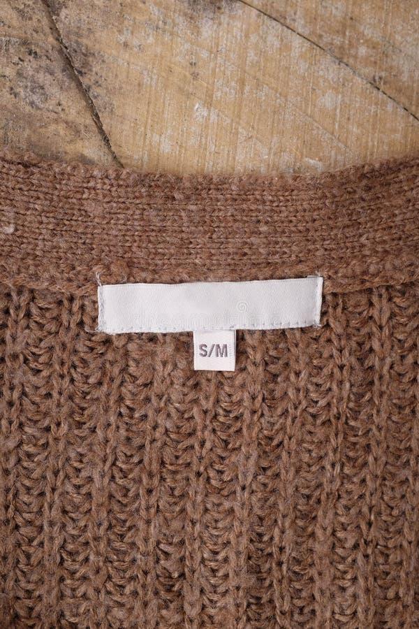 Ντύνοντας ετικέτες στο ξύλινο υπόβαθρο στοκ φωτογραφία με δικαίωμα ελεύθερης χρήσης