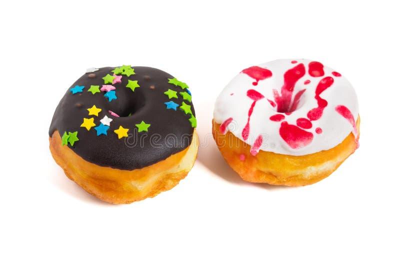 Νόστιμος που βερνικώνεται donuts απομονωμένος στο άσπρο υπόβαθρο στοκ φωτογραφίες με δικαίωμα ελεύθερης χρήσης