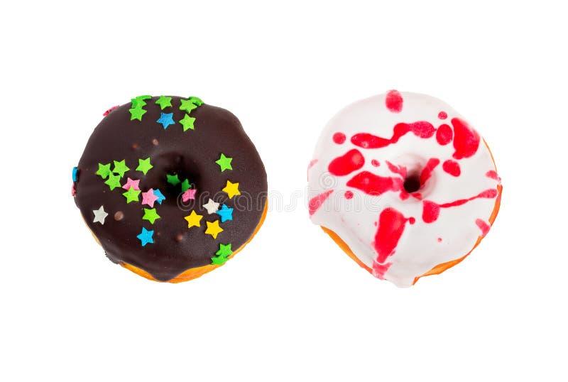 Νόστιμος που βερνικώνεται donuts απομονωμένος στο άσπρο υπόβαθρο στοκ φωτογραφία