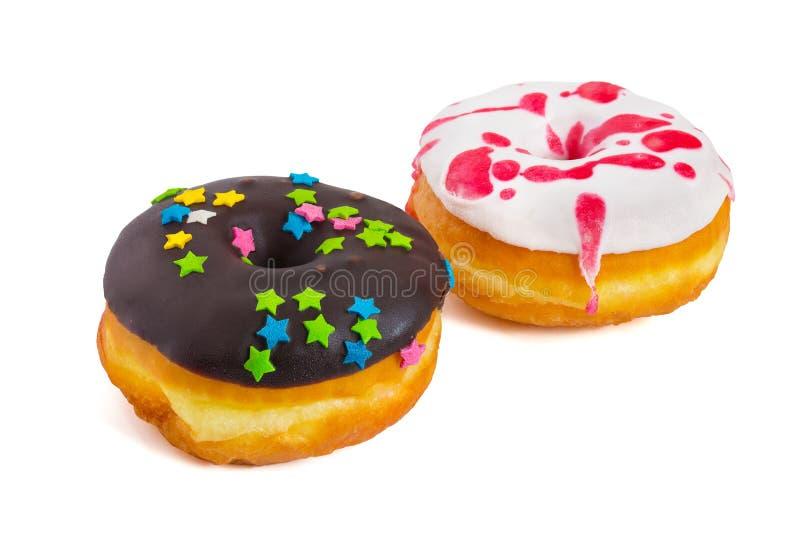 Νόστιμος που βερνικώνεται donuts απομονωμένος στο άσπρο υπόβαθρο στοκ φωτογραφία με δικαίωμα ελεύθερης χρήσης
