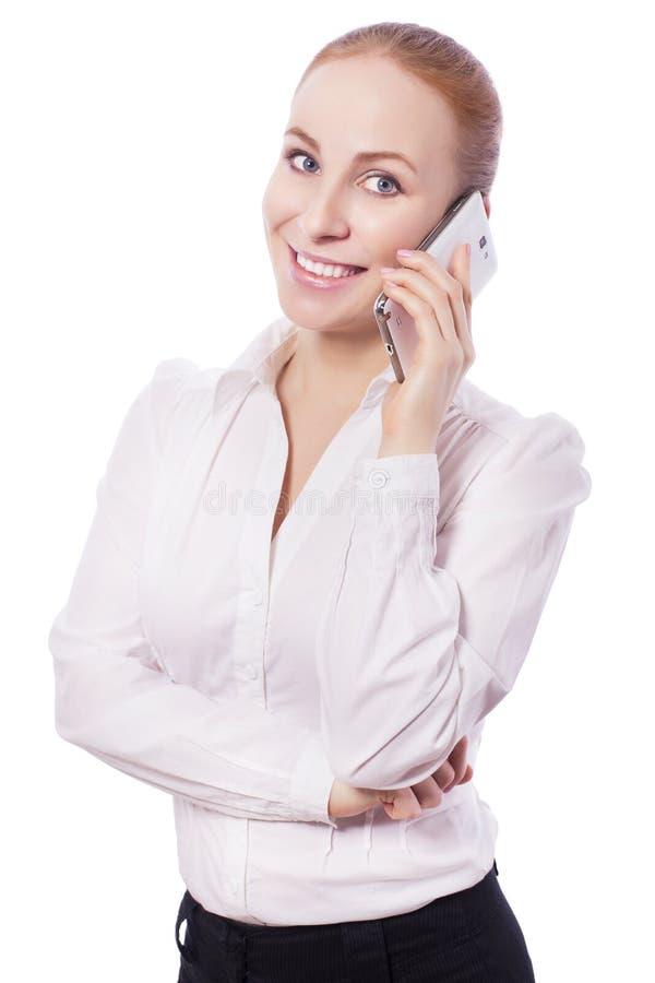 Ξανθά χαμόγελα εργαζομένων διευθυντών επιχειρησιακών γυναικών και ομιλία σε ένα pho στοκ φωτογραφία