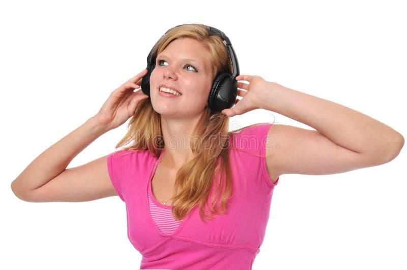 ξανθές νεολαίες ακουστικών στοκ εικόνες