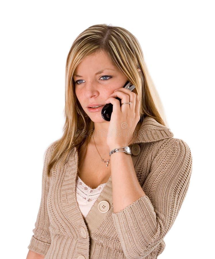 ξανθές συνοφρύές νεολαίες τηλεφωνικών ομιλούσες γυναικών στοκ φωτογραφία με δικαίωμα ελεύθερης χρήσης