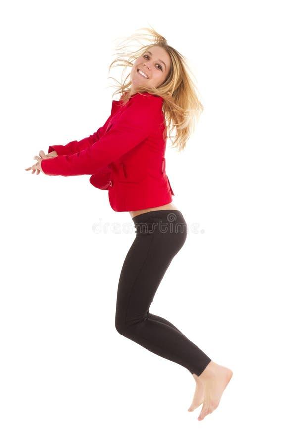 ξανθή πηδώντας γυναίκα στοκ εικόνες με δικαίωμα ελεύθερης χρήσης