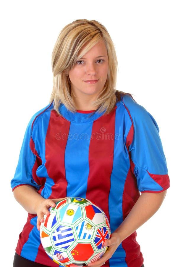 ξανθό ποδόσφαιρο κοριτσιών στοκ φωτογραφία με δικαίωμα ελεύθερης χρήσης