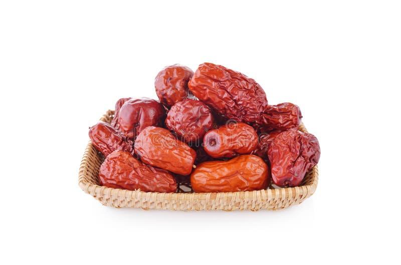 Ξηρά κινεζικά Jujube φρούτα στο καλάθι μπαμπού και στο άσπρο backgro στοκ εικόνες