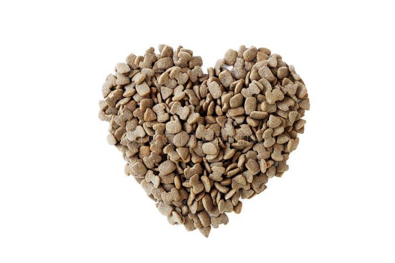 Ξηρά μορφή καρδιών τροφίμων κατοικίδιων ζώων που απομονώνεται στοκ εικόνα με δικαίωμα ελεύθερης χρήσης