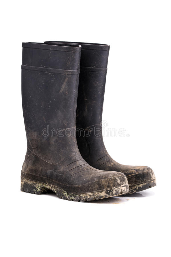Ξηρές βρώμικες μπότες λάσπης που απομονώνονται στην άσπρη 3/4 άποψη στοκ φωτογραφία