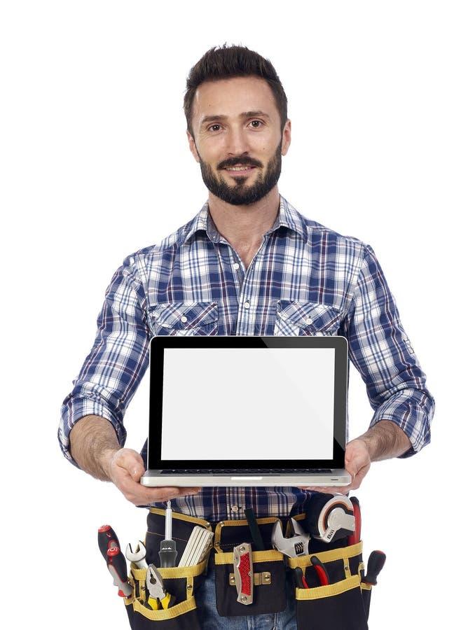Ξυλουργός που παρουσιάζει lap-top στοκ φωτογραφία με δικαίωμα ελεύθερης χρήσης