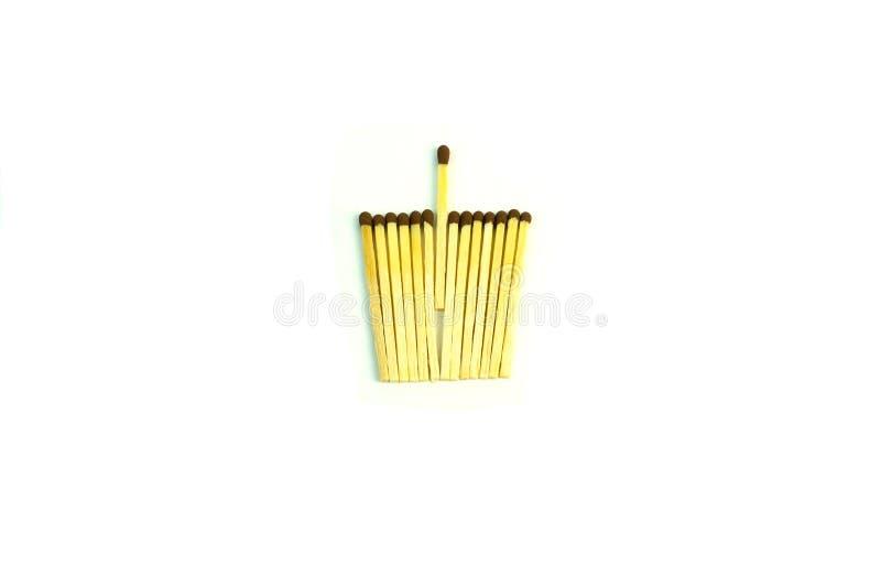 Ξύλινα matchsticks με το θείο Φωτογραφία στην άσπρη ανασκόπηση στοκ εικόνες