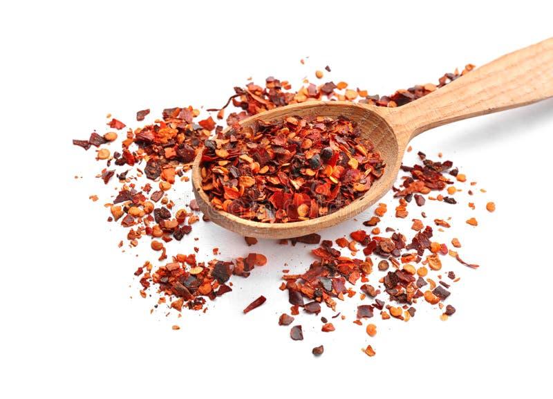 Ξύλινες νιφάδες πιπεριών κουταλιών και τσίλι στοκ φωτογραφία με δικαίωμα ελεύθερης χρήσης