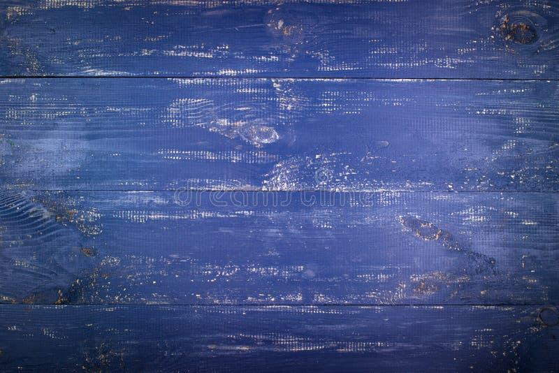 Ξύλινη ανασκόπηση σύστασης Η επιφάνεια της παλαιάς ξύλινης σύστασης Οι πίνακες είναι χρωματισμένοι σε σκούρο μπλε στοκ φωτογραφίες