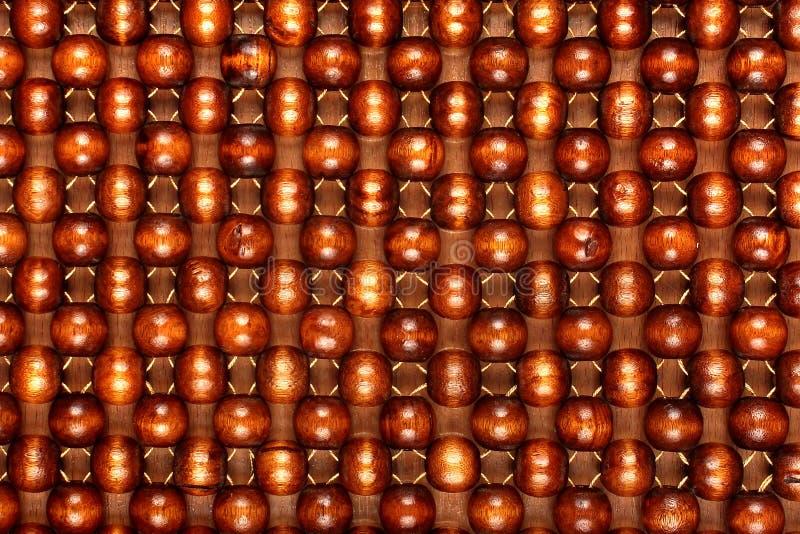 Ξύλινη κουβέρτα χαντρών Χέρι - γίνοντα κάθισμα αυτοκινήτων Φυσικό λουστραρισμένο ξύλινο υπόβαθρο στοκ εικόνες