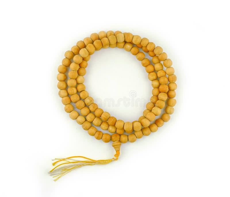 Ξύλινη rosary χάντρα στο λευκό στοκ φωτογραφία με δικαίωμα ελεύθερης χρήσης