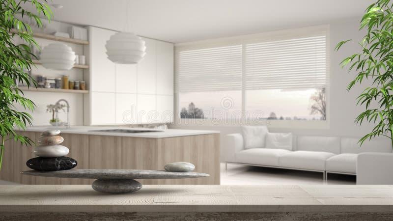 Ξύλινο εκλεκτής ποιότητας πίνακας ή ράφι με την ισορροπία πετρών, πέρα από τη θολωμένη σύγχρονη άσπρη και ξύλινη κουζίνα με τα ρά ελεύθερη απεικόνιση δικαιώματος