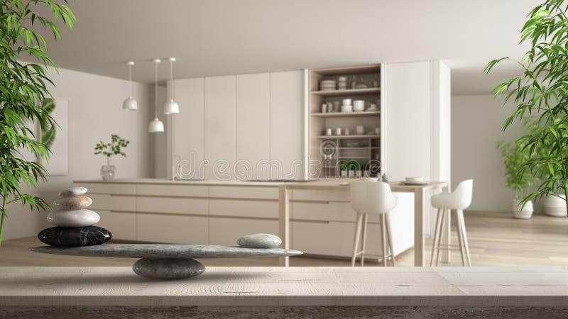 Ξύλινο εκλεκτής ποιότητας πίνακας ή ράφι με την ισορροπία πετρών, πέρα από τη θολωμένη σύγχρονη άσπρη κουζίνα με τις ξύλινες λεπτ ελεύθερη απεικόνιση δικαιώματος