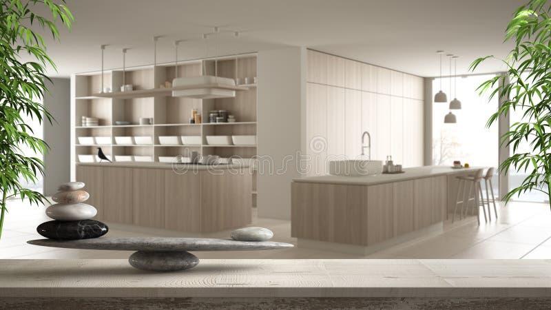 Ξύλινο εκλεκτής ποιότητας πίνακας ή ράφι με την ισορροπία πετρών, πέρα από τη θολωμένη σύγχρονη άσπρη κουζίνα με τις ξύλινες λεπτ απεικόνιση αποθεμάτων