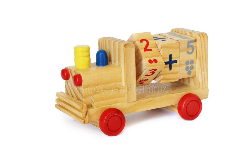 Ξύλινο παιχνίδι σε ένα άσπρο υπόβαθρο Ατμομηχανή στοκ εικόνα