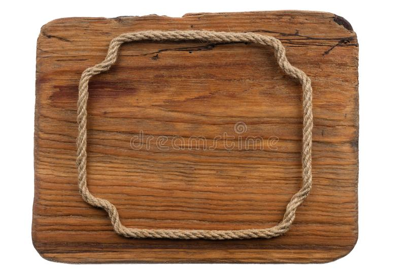Ξύλινο σημάδι και ένα πλαίσιο φιαγμένο από σχοινί που απομονώνεται στο άσπρο υπόβαθρο στοκ εικόνα