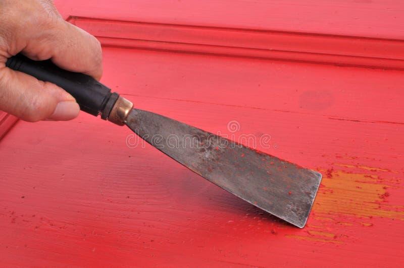 Ξύστε επάνω τη ζωγραφική κινηματογραφήσεων σε πρώτο πλάνο με spatula στοκ εικόνες