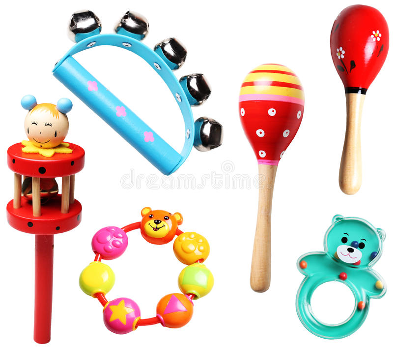 Ξύλινα και πλαστικά κουδουνίσματα για τα παιδιά στοκ εικόνες με δικαίωμα ελεύθερης χρήσης