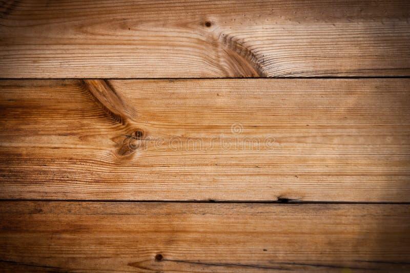 Ξύλινη πεύκων ανασκόπηση σύστασης σανίδων καφετιά στοκ φωτογραφία