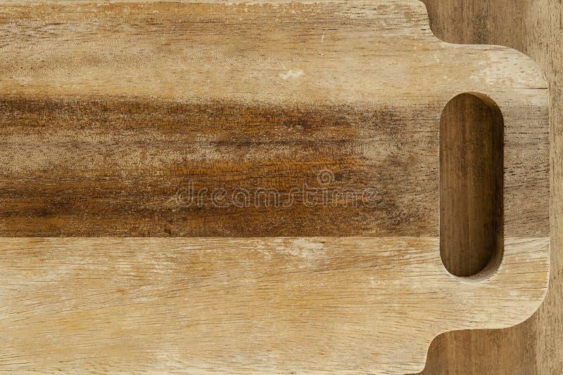Ξύλινος τέμνων πίνακας με τη λαβή στοκ φωτογραφίες